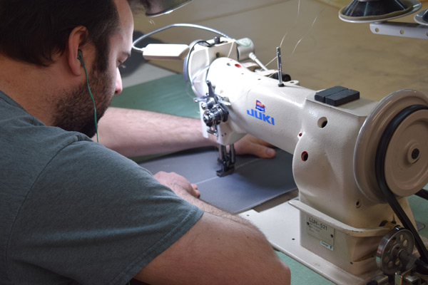 Knights Upholstery team member sewing
